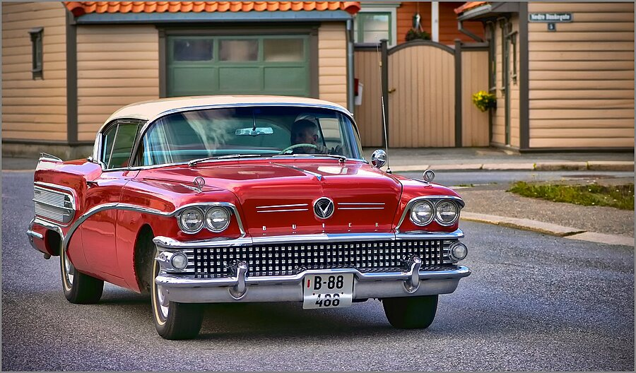This old Buick coming down the street | NIKON 105MM F/2.8G ED-IF AF-S VR MICRO N <br> Click image for more details, Click <b>X</b> on top right of image to close