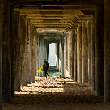 HB Surfer Under Pier | LENS MODEL NOT SET