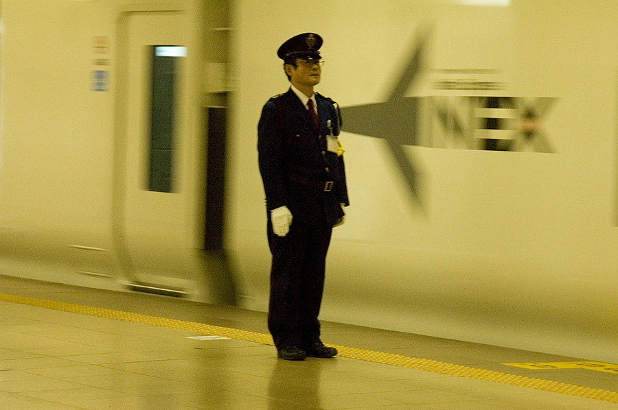 Subway Attendant, Tokyo | NIKON 28-200MM F/3.5-5.6D IF AF <br> Click image for more details, Click <b>X</b> on top right of image to close