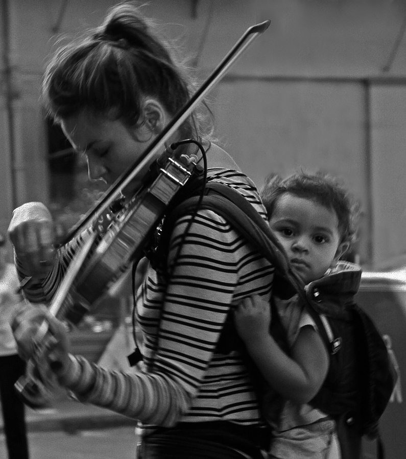 nikonimages.com gallery | Street musician and child-2 | Lens model not set | FA