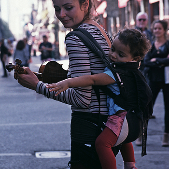 Street musician and her child-New Orleans