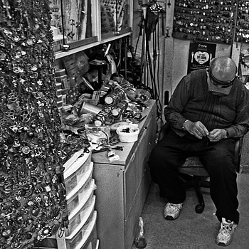 The Jeweler in his shop | NIKON 24MM F/2.0 <br> Click image for more details, Click <b>X</b> on top right of image to close